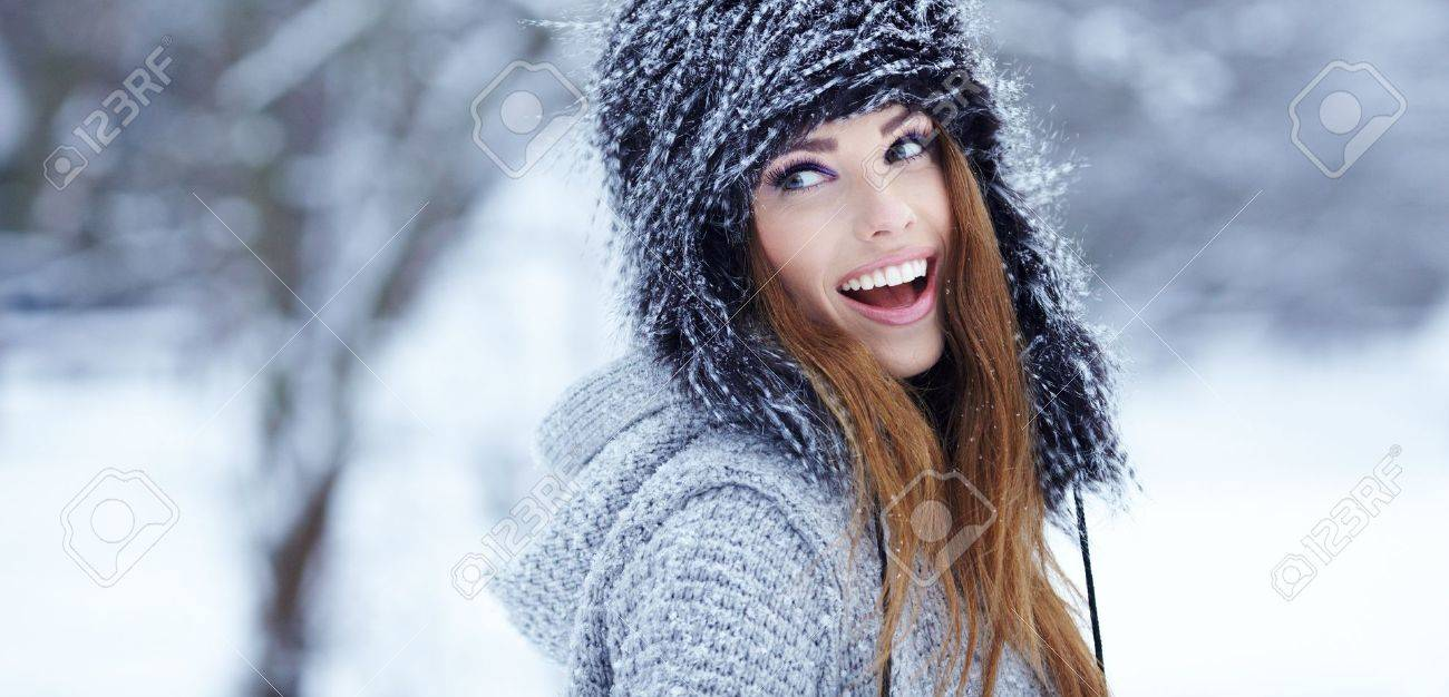 Girl playing with snow in park Stock Photo - 17130158