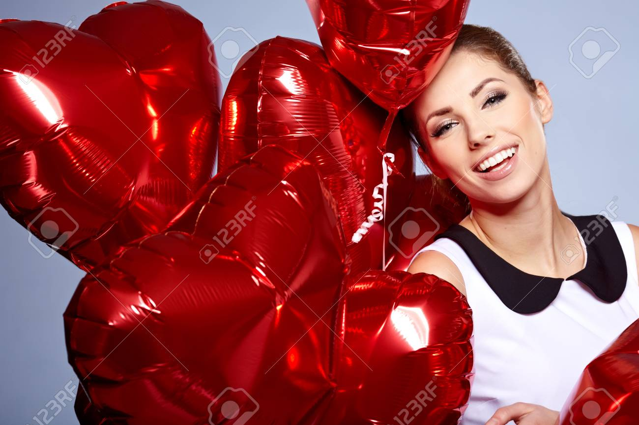 woman with red heart balloon Stock Photo - 17255311