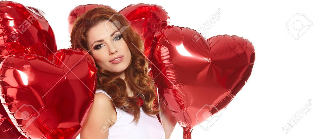 woman with red heart balloon on a white background Stock Photo - 17501583