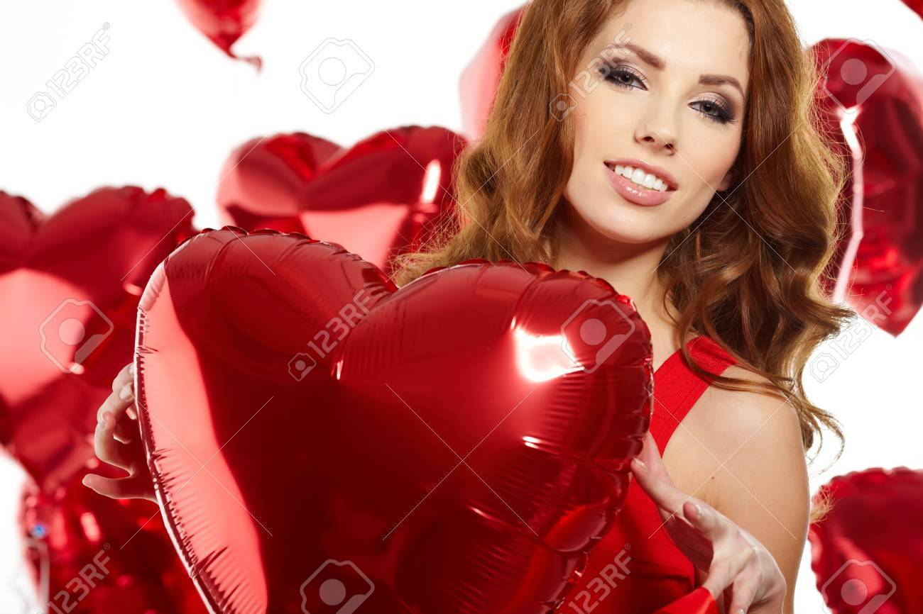 woman with red heart balloon on a white background Stock Photo - 17501593