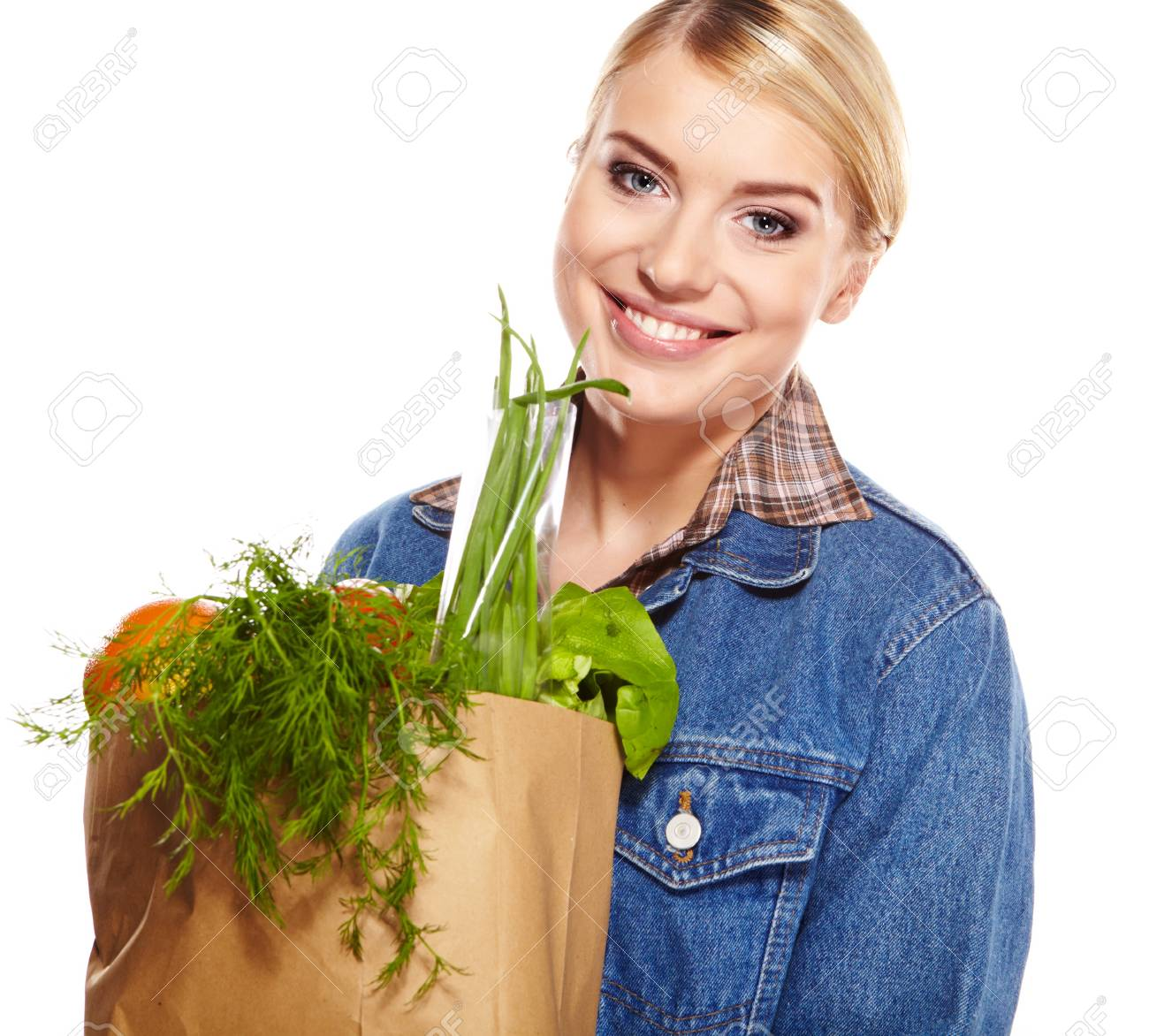Portrait of happy young woman holding a shopping bag full of groceries on white background Stock Photo - 17564552