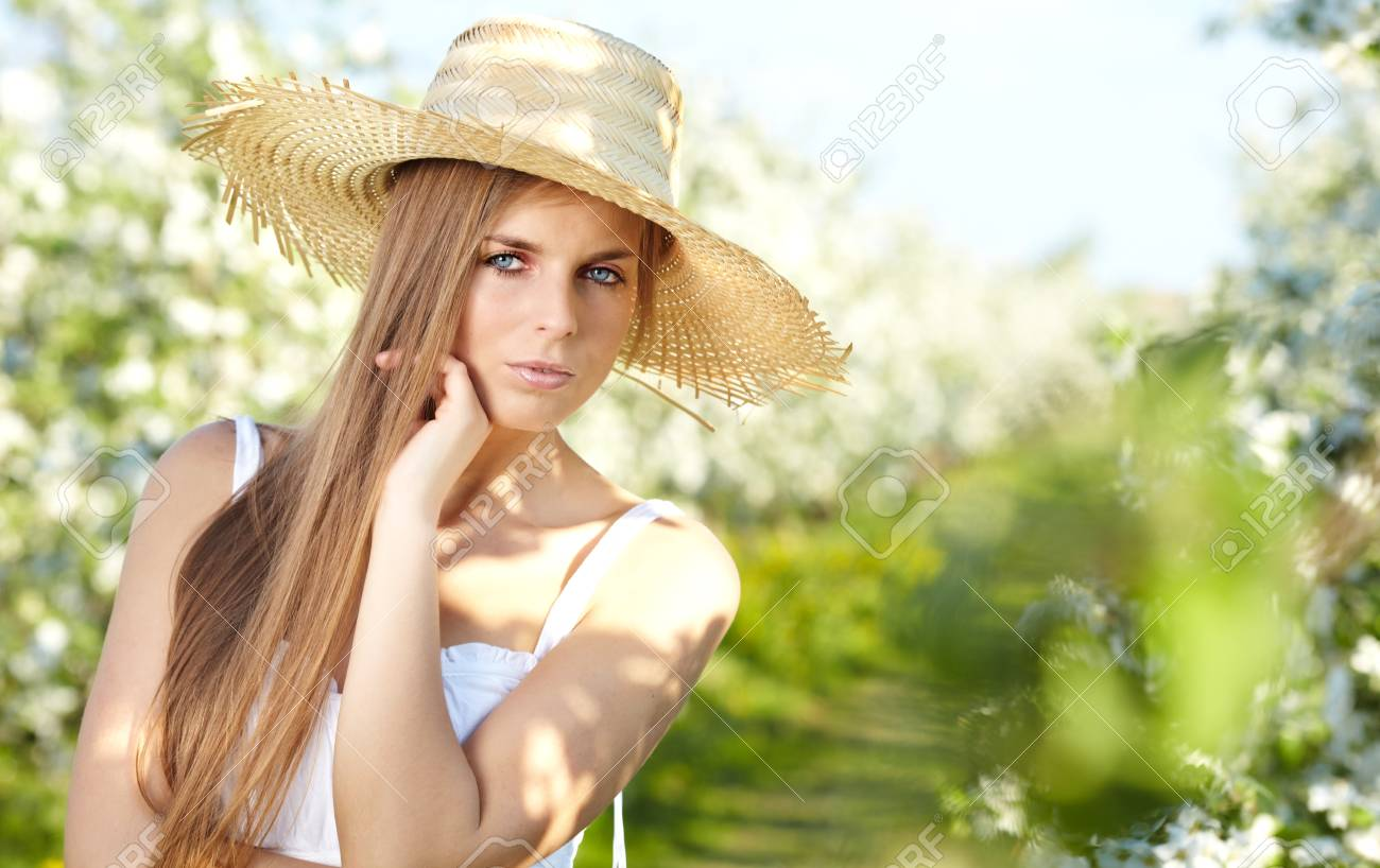 beautiful blonde in a spring garden Stock Photo - 18206600
