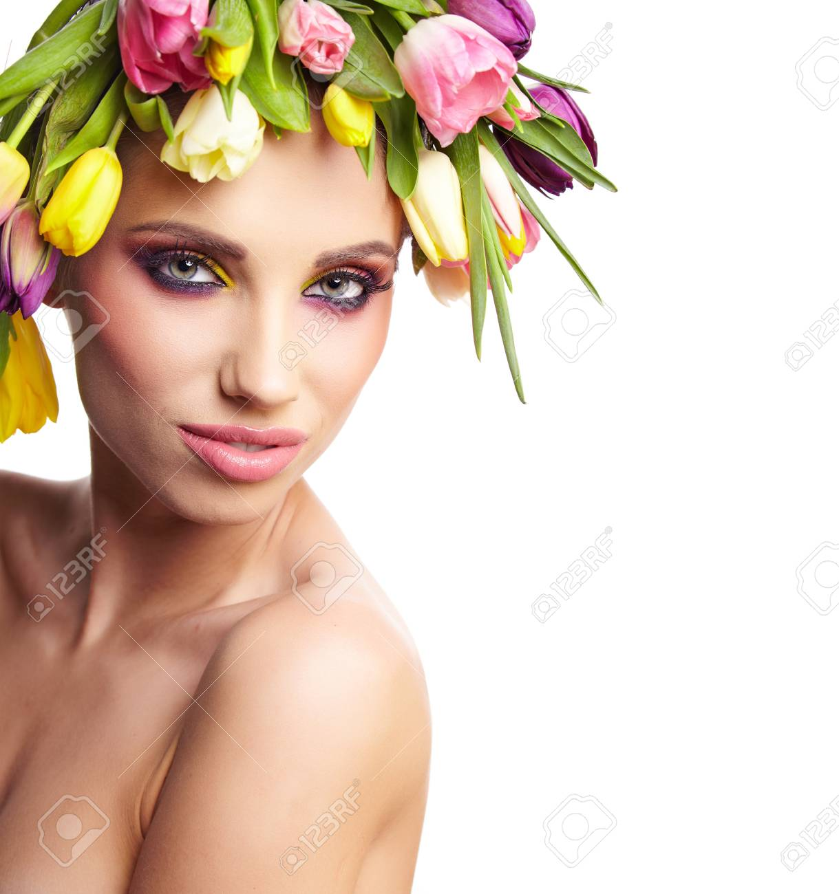 fashion model with large hairstyle and flowers in her hair Stock Photo - 19349529