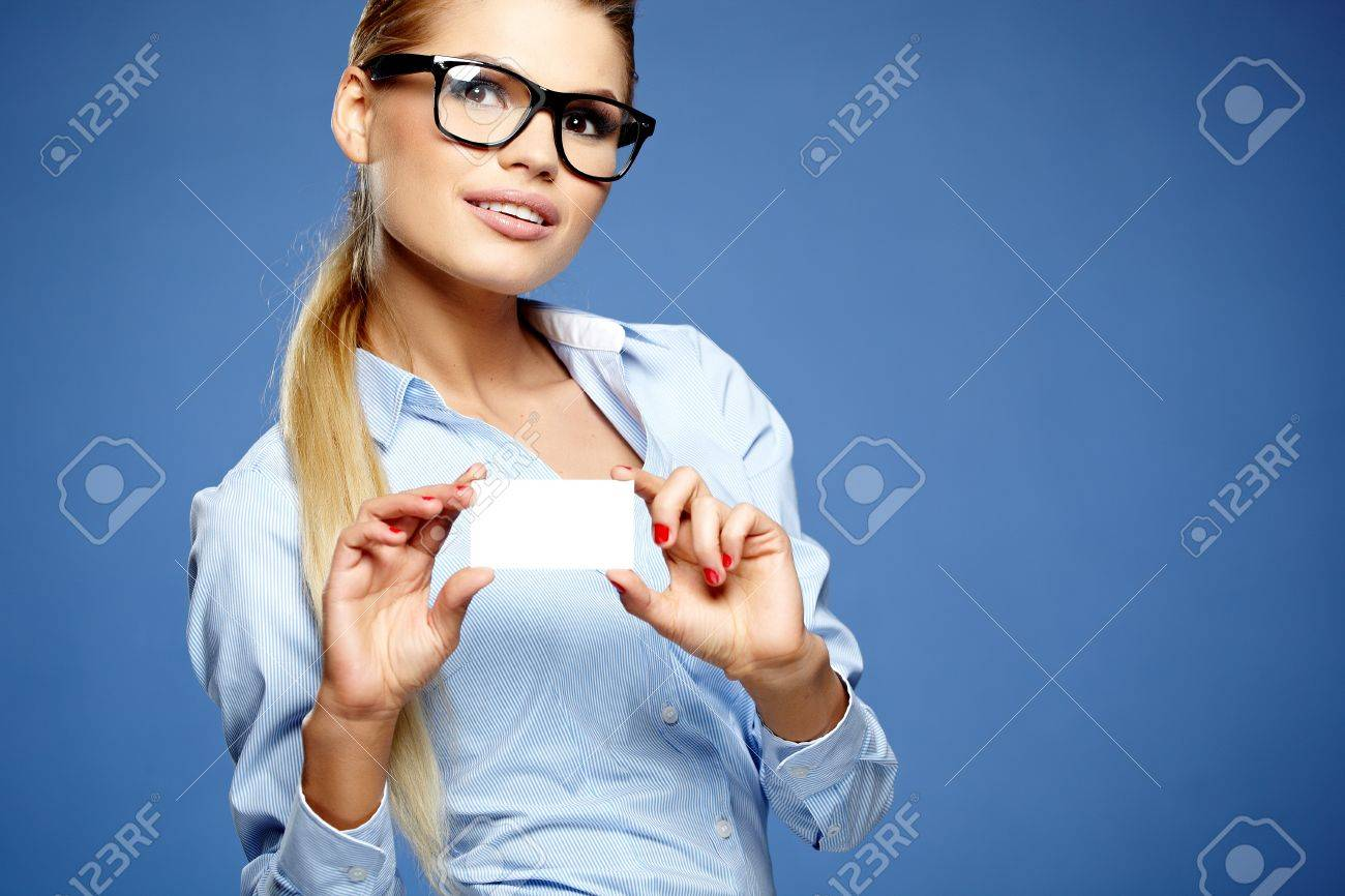 Businesswoman holding credit card. Isolated on blue Stock Photo - 19874989