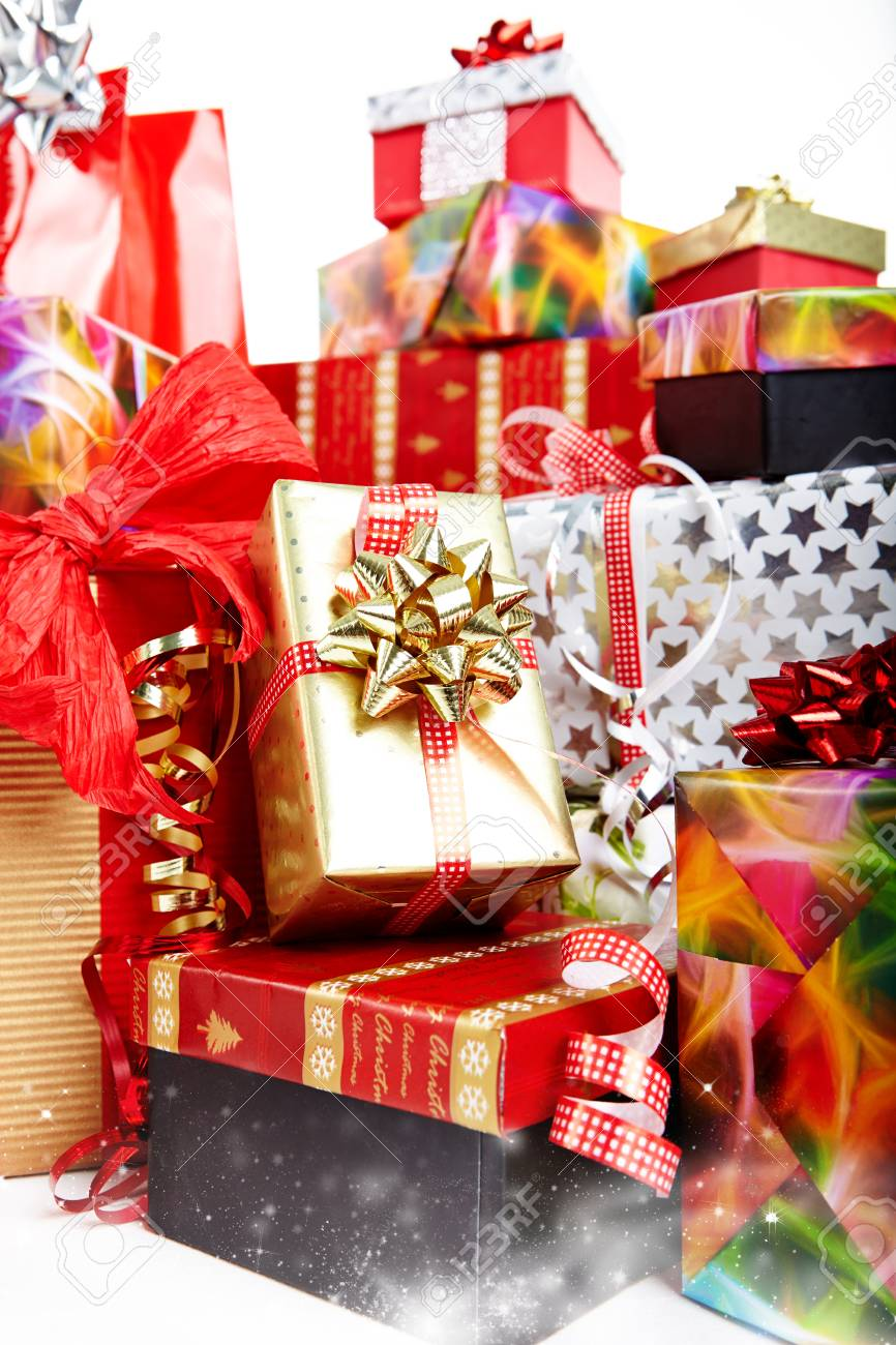 A Pile Of Christmas Gifts In Colorful Wrapping With Ribbons Stock Photo