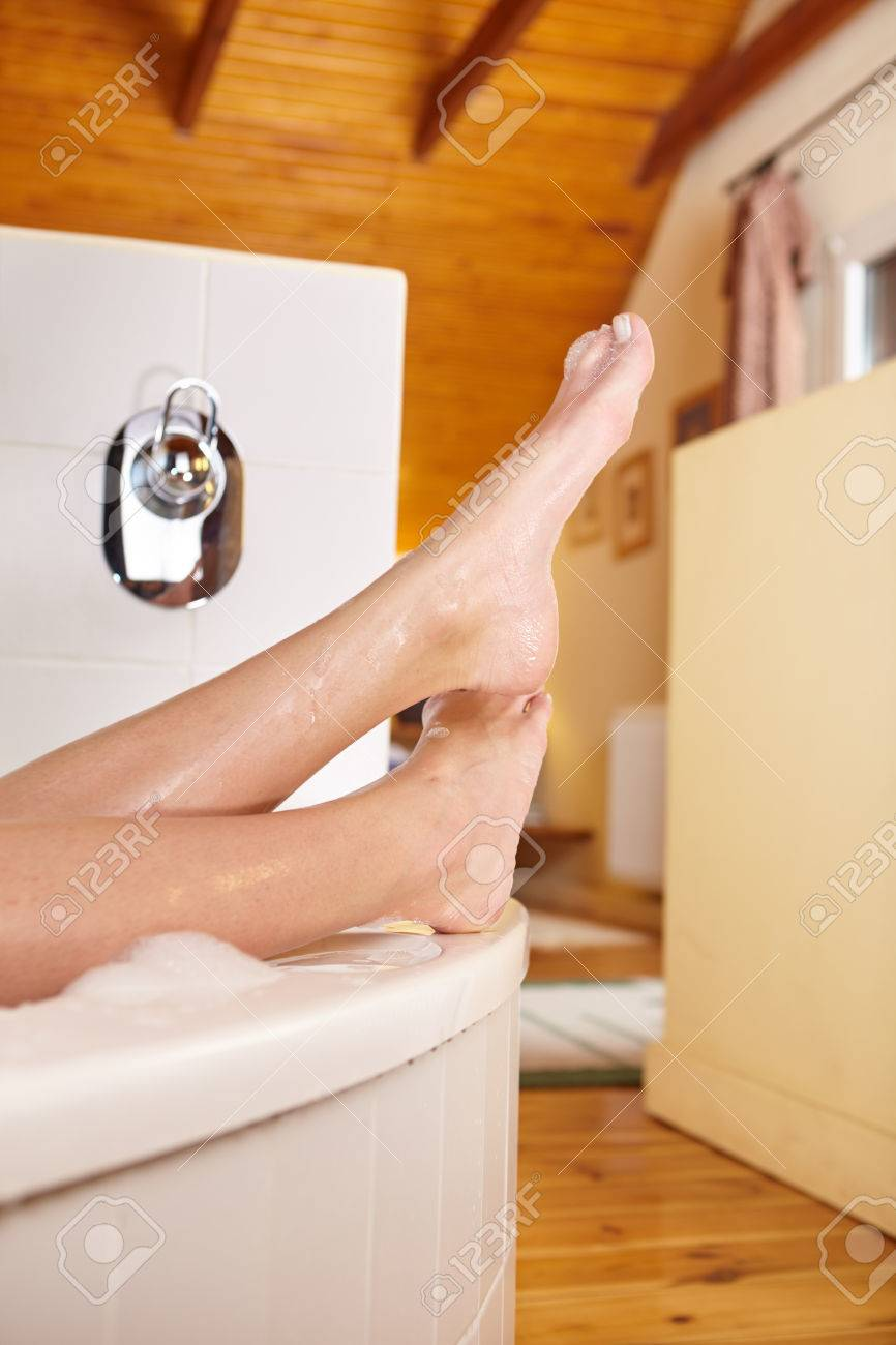 Bathtime. Girl\'s Feet Sticking Out From Bath Tub. Stock Photo ...