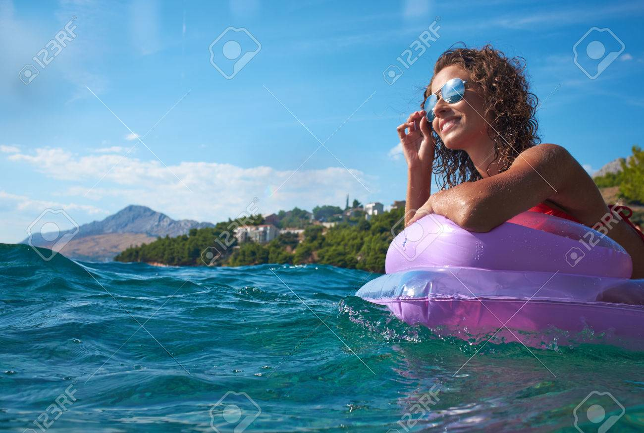 girl floating on a mattress in the Adriatic Sea Standard-Bild - 37234416