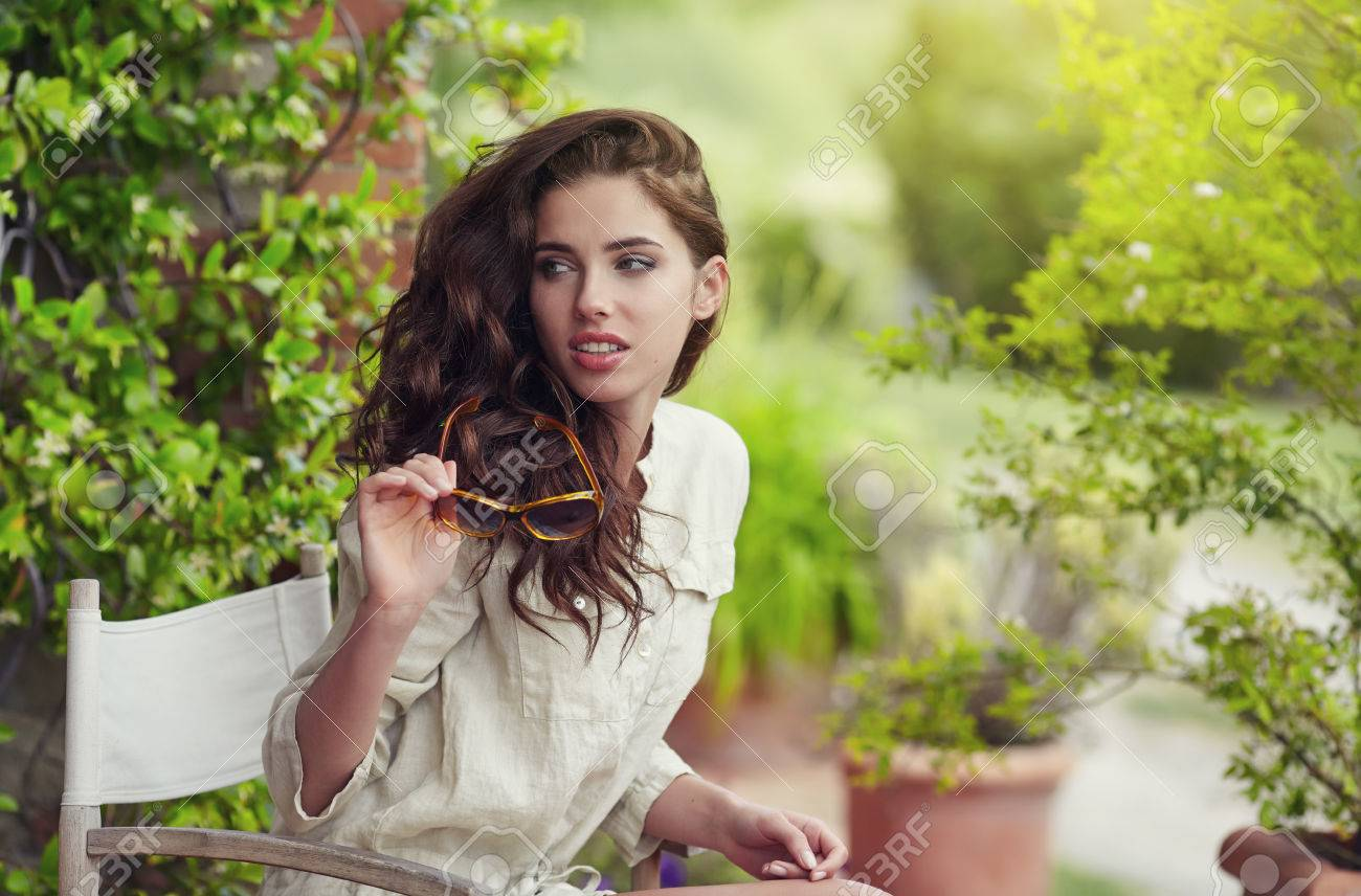 Beautiful Woman On The Terrace Of An Italian Country Garden Stock Photo