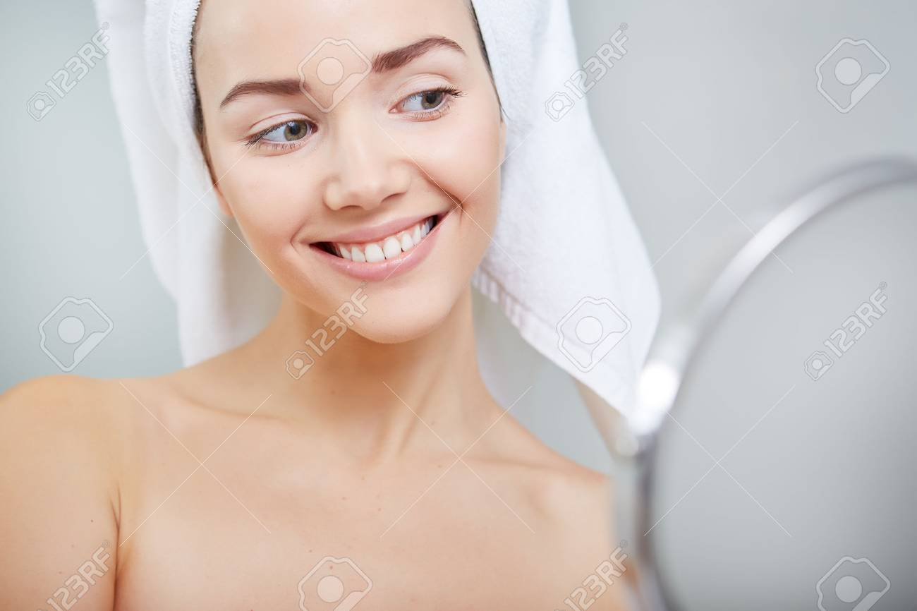 face of young beautiful healthy woman and reflection in the mirror - 51686354