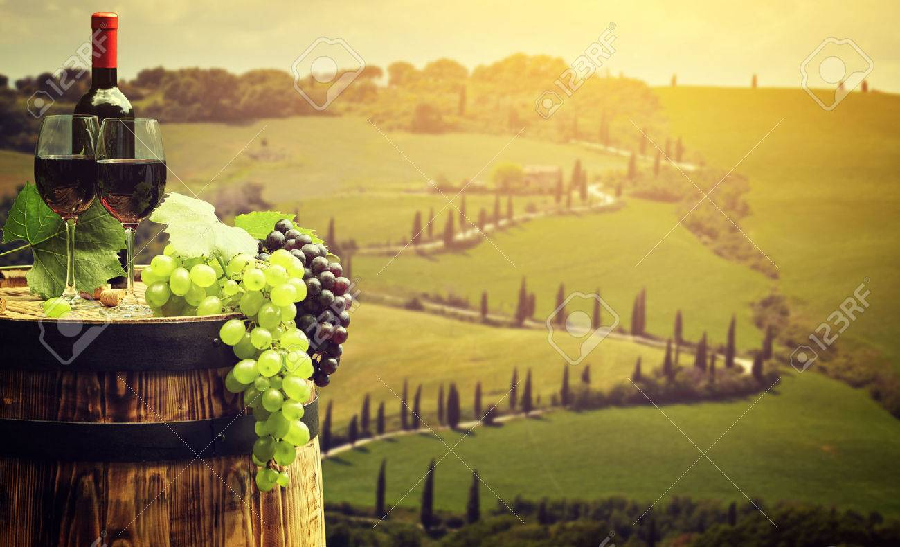 Red wine with barrel on vineyard in green Tuscany, Italy - 51802789