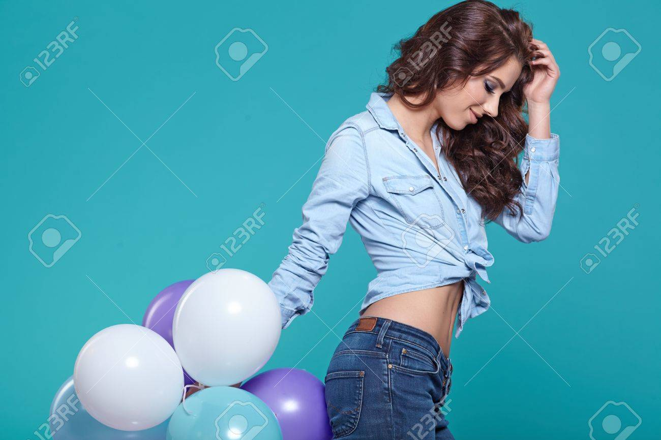 Beautiful woman with colored balloons - 52038784