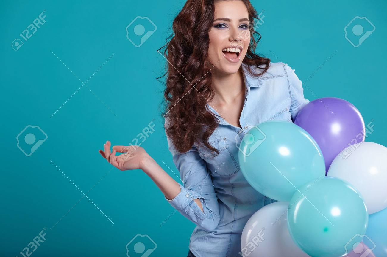 Young pretty woman with colored balloons - 53523334