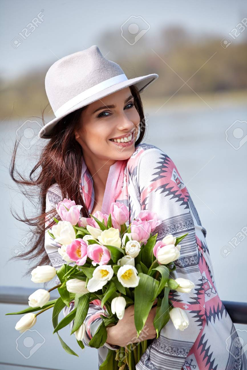 Woman with tulips beautiful woman with flowers stock photo woman with tulips beautiful woman with flowers stock photo 55361184 izmirmasajfo Image collections