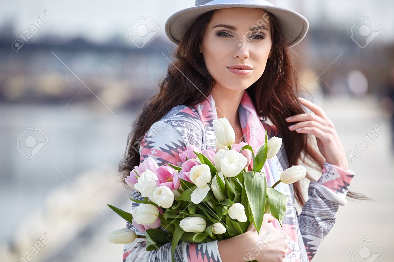 Woman with tulips beautiful woman with flowers stock photo stock photo woman with tulips beautiful woman with flowers izmirmasajfo
