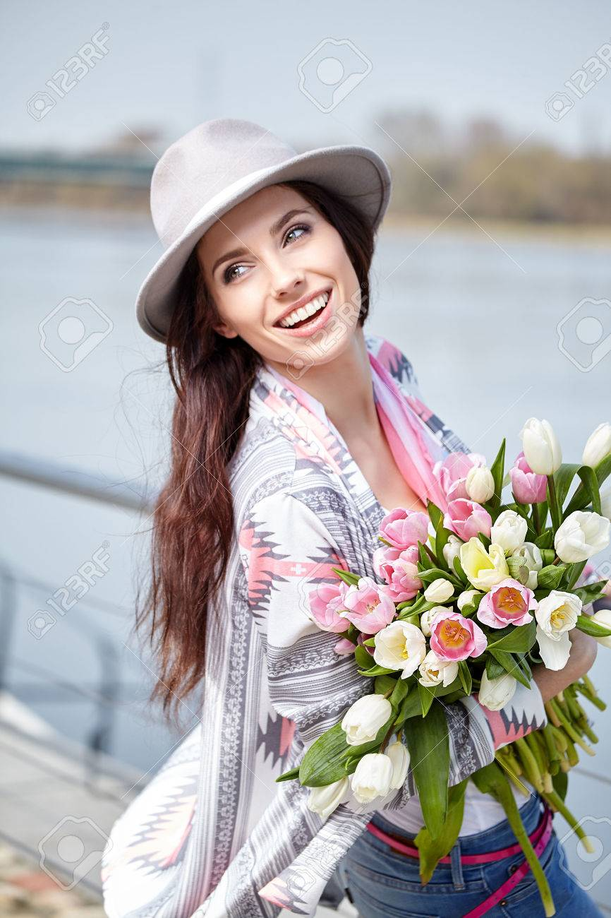 Woman with tulips. Beautiful woman with flowers. - 55361576
