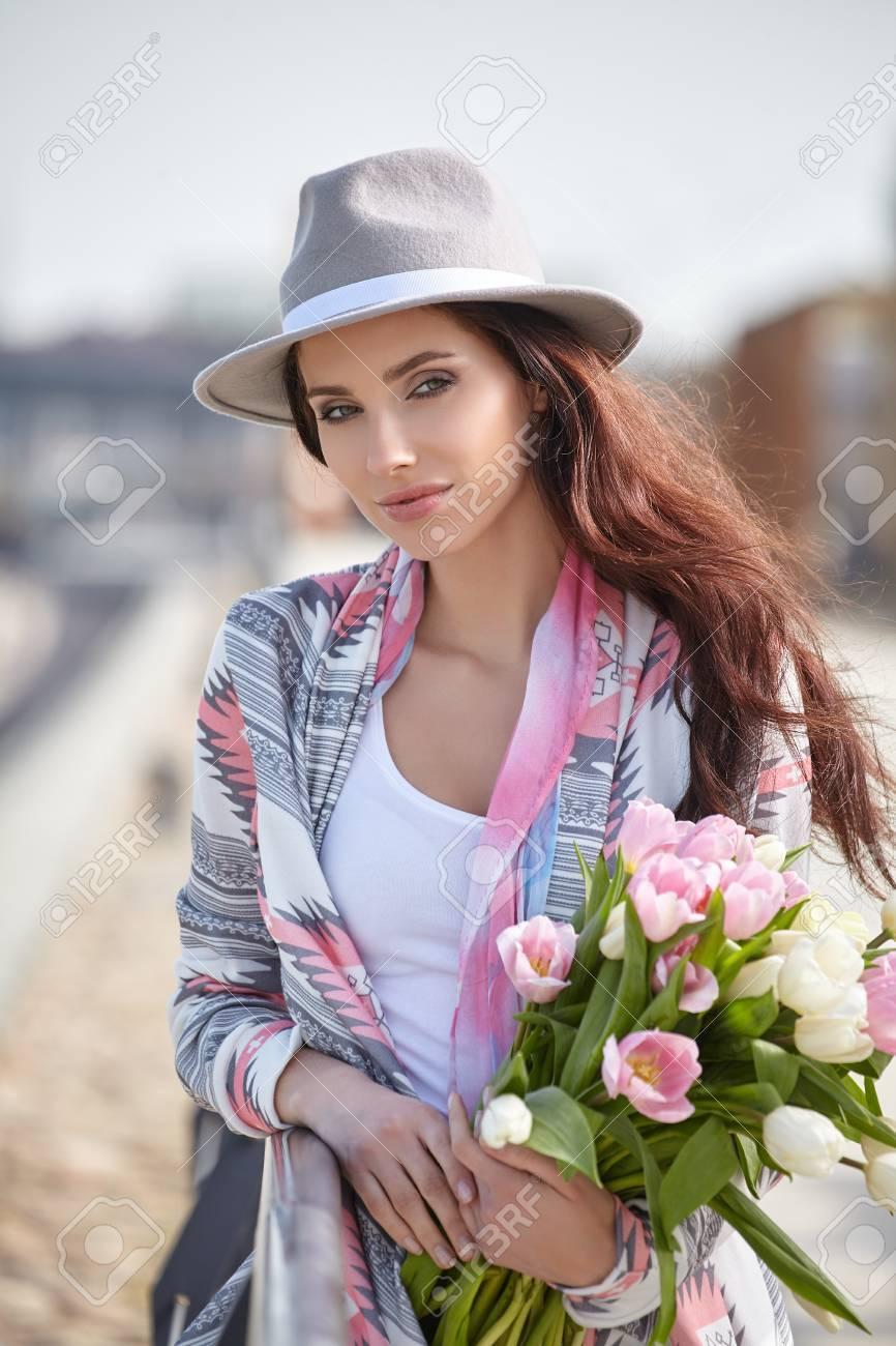 Woman with tulips beautiful woman with flowers stock photo stock photo woman with tulips beautiful woman with flowers izmirmasajfo Image collections