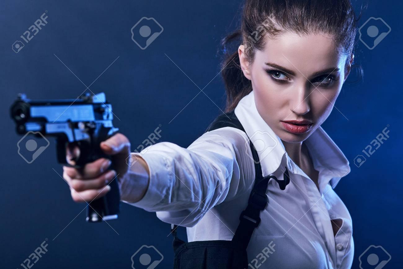 beautiful girl holding gun . smoke background - 55865065