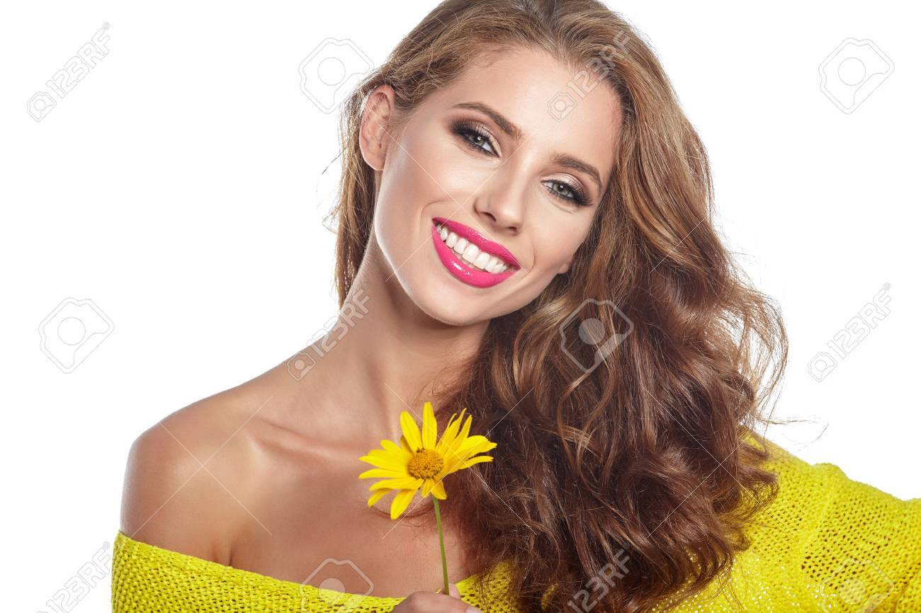 Portrait of young beautiful woman with stylish make-up and sunflower - 71186989