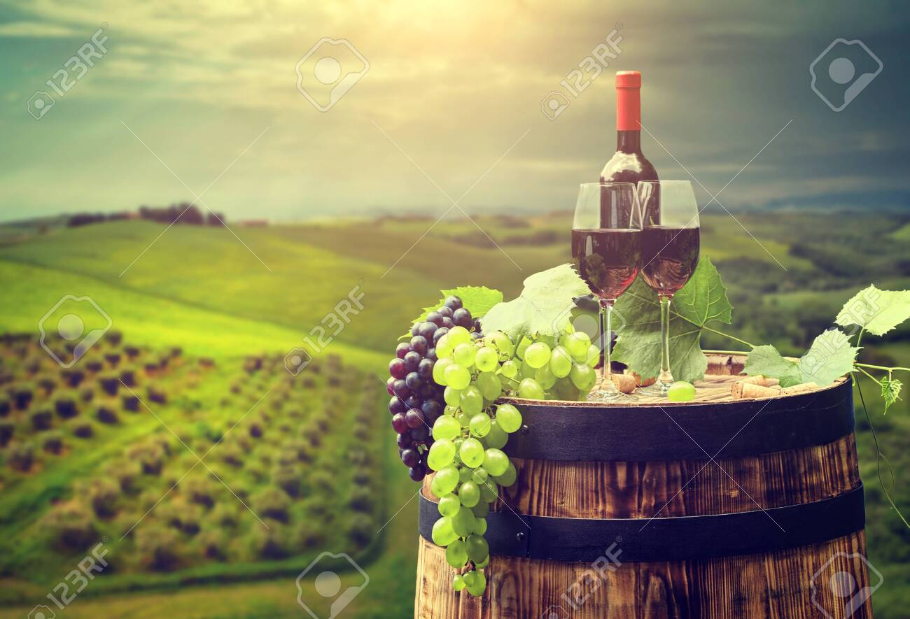 red wine bottle and wine glass on wodden barrel - 150182934