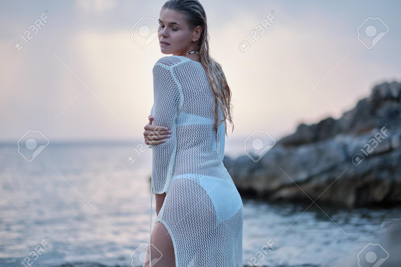 A woman on a rocky beach in Croatia. - 162108028