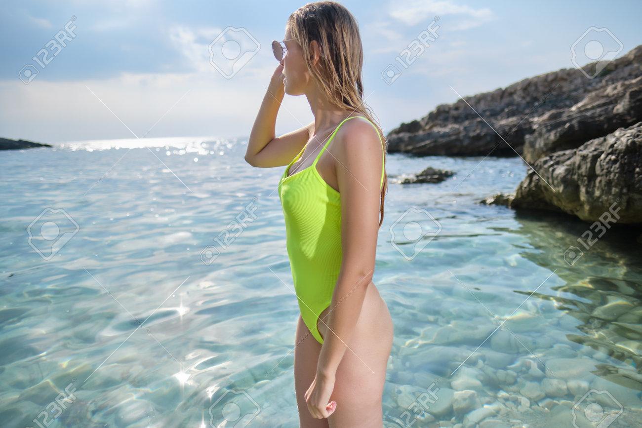 A woman on a rocky beach in Croatia. - 162108030