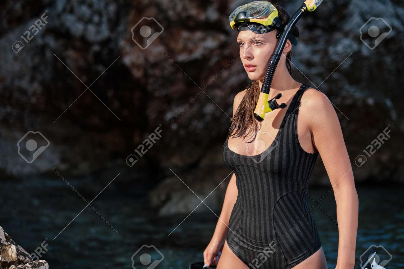 Sexy underwater hunter woman - 163802646