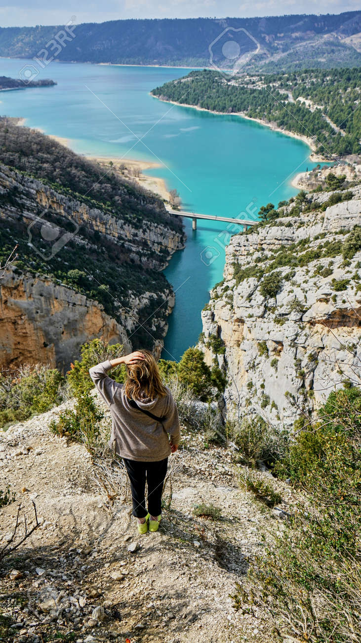Woman View on Guadalest water reservoir with turquoise water in Alicante province Spain - 166438509