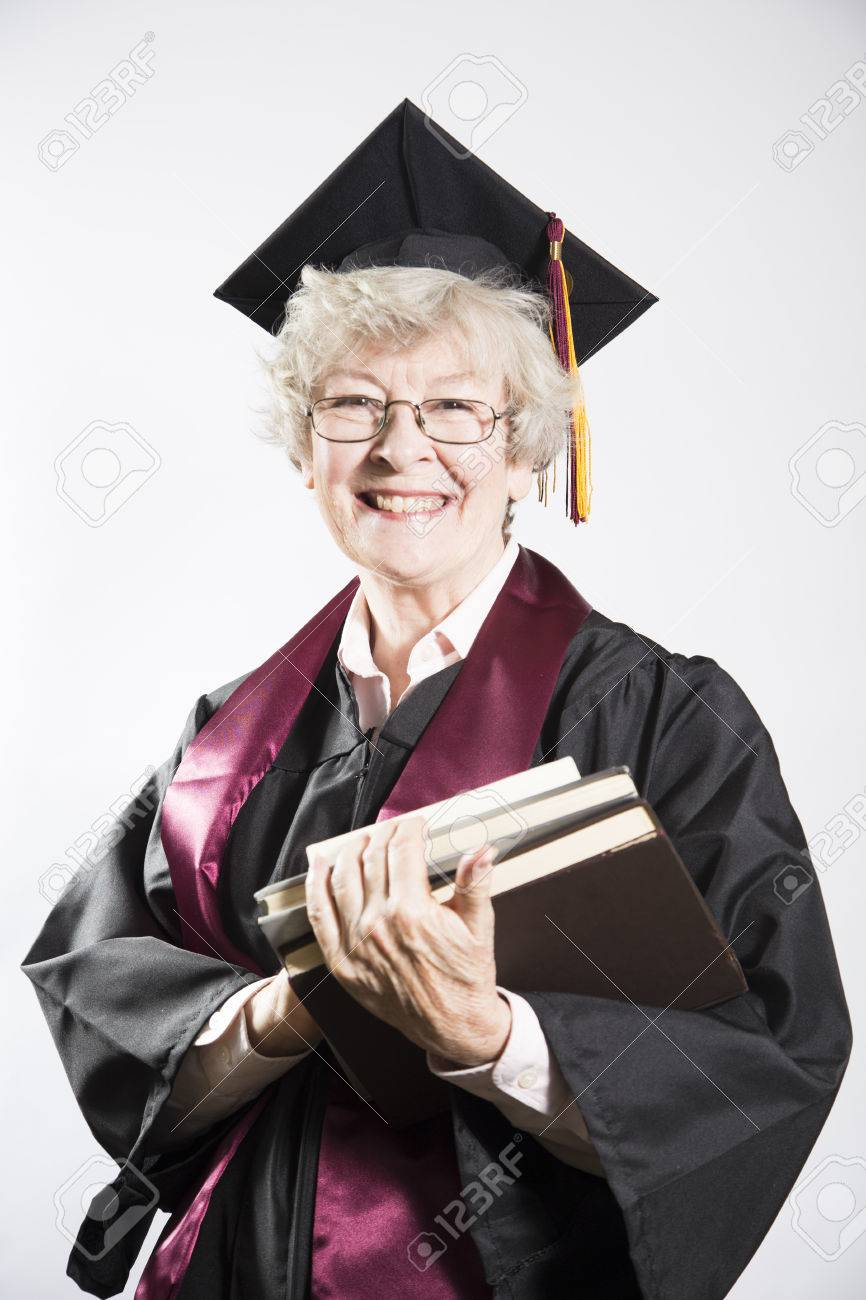 elderly college graduate holding books stock photo picture and elderly college graduate holding books stock photo 24045241
