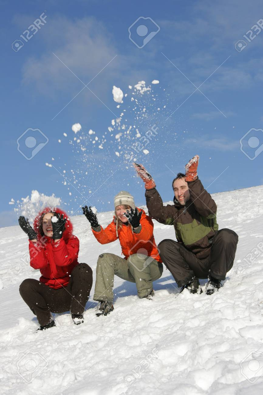Friends have fun on flank of hill in winter Stock Photo - 2481882