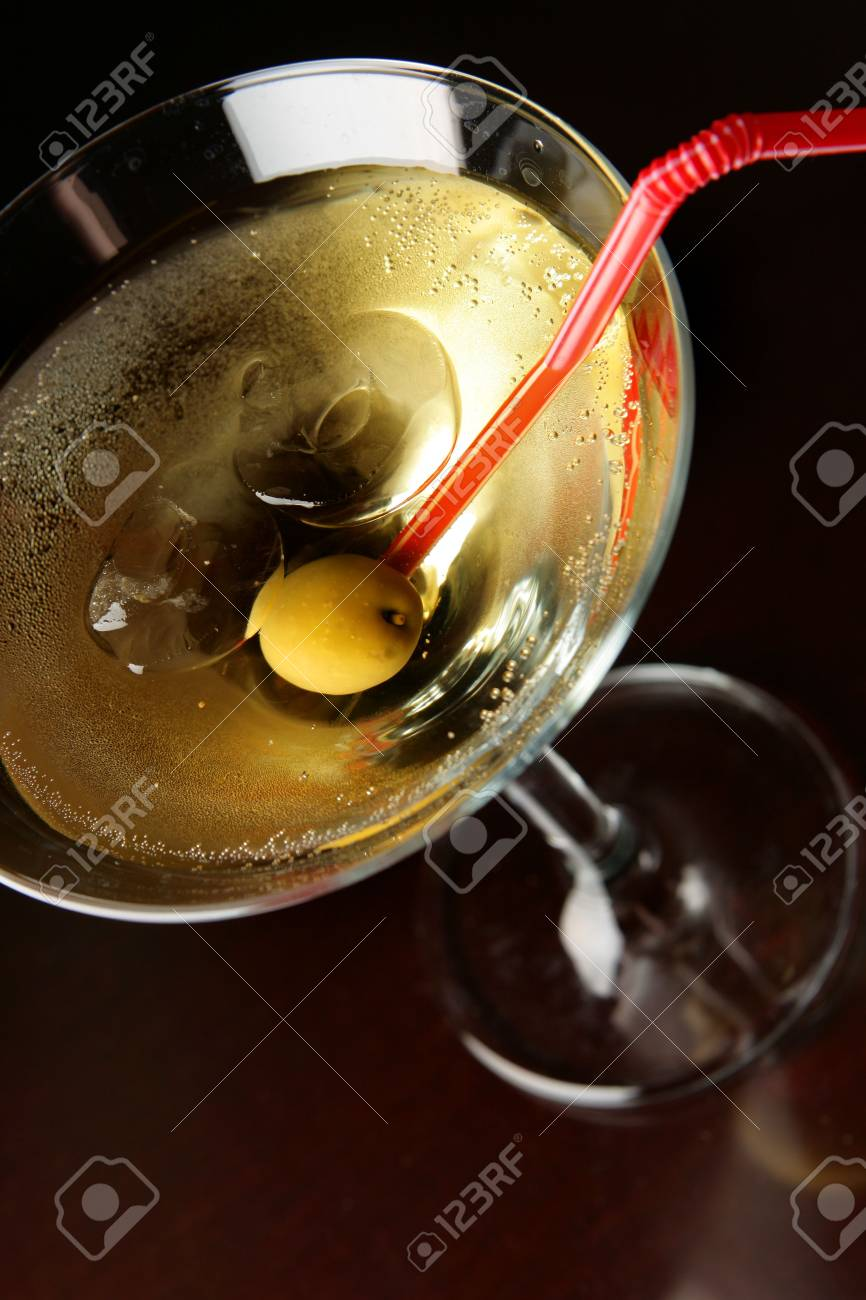 Cocktail glass with ice and olive close-up over black background Stock Photo - 3865472