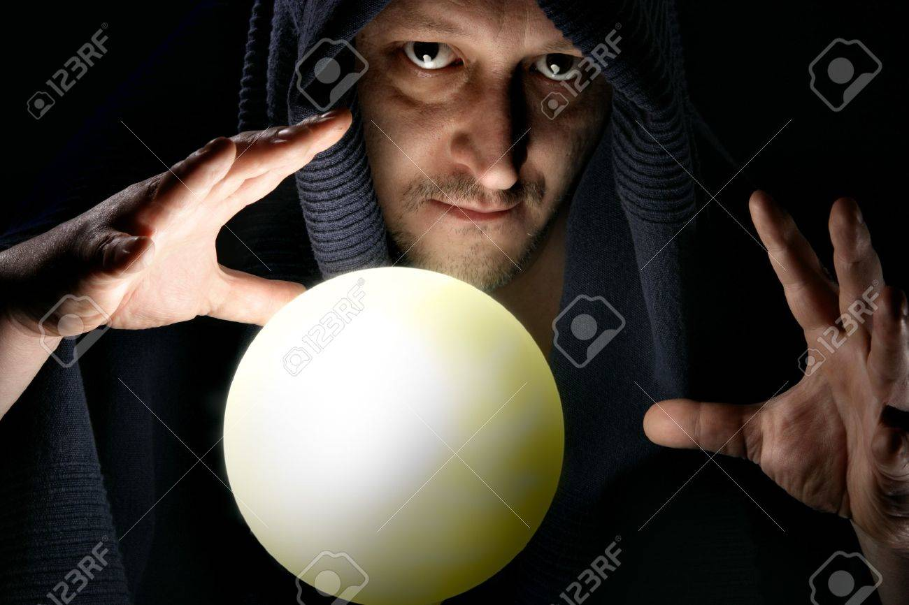 Sorcerer with glowing magical sphere close-up Stock Photo - 4251171