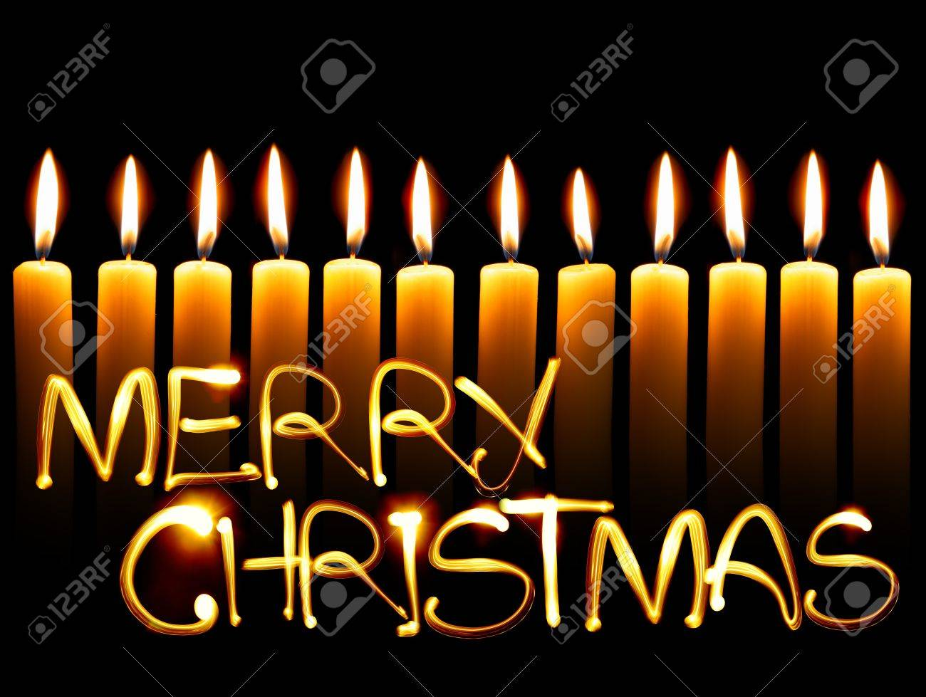 Created by light text Merry Christmas and candles Stock Photo - 8242909