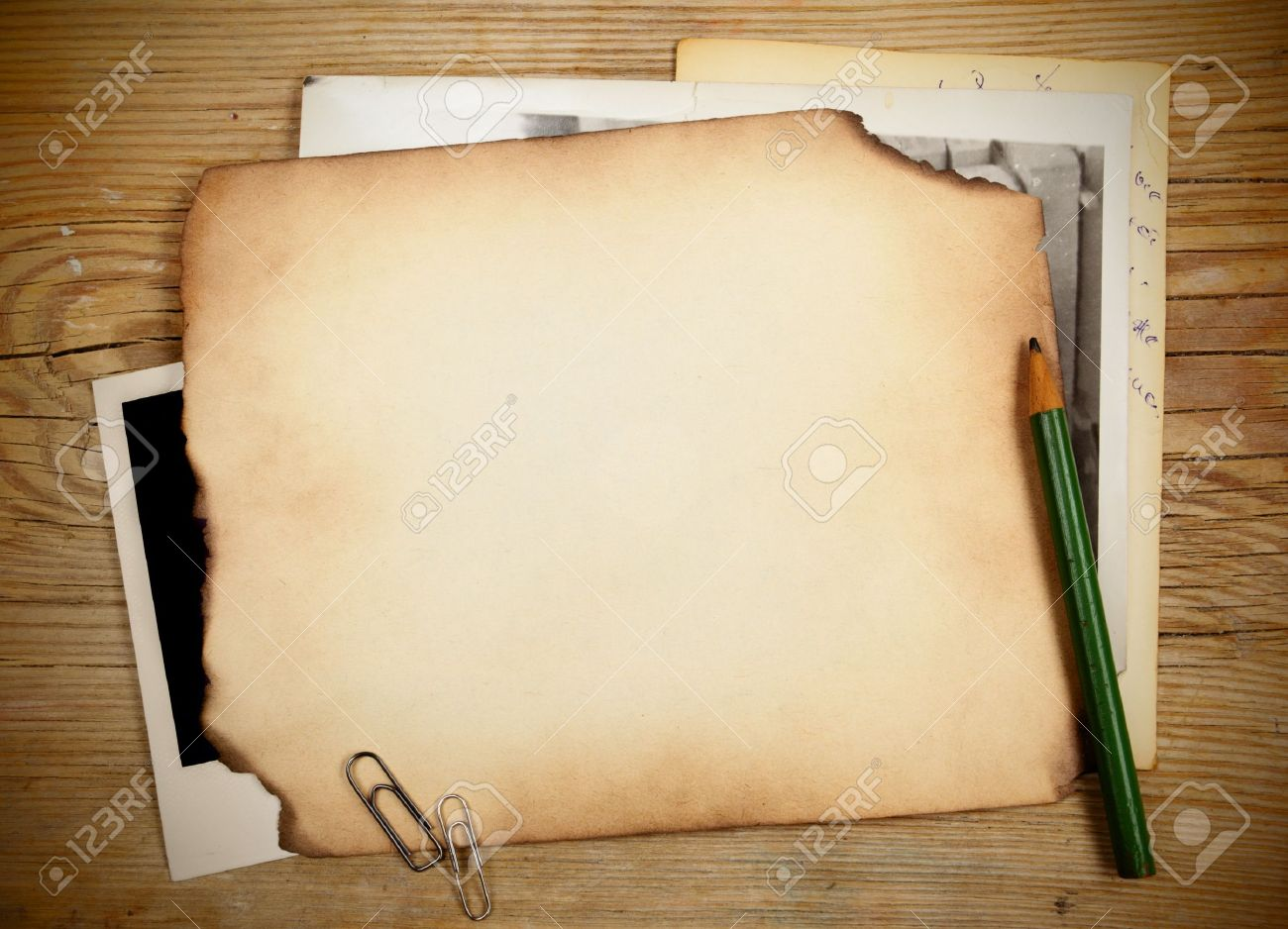 Stack of old papers and photos on a wooden table Stock Photo - 9920108