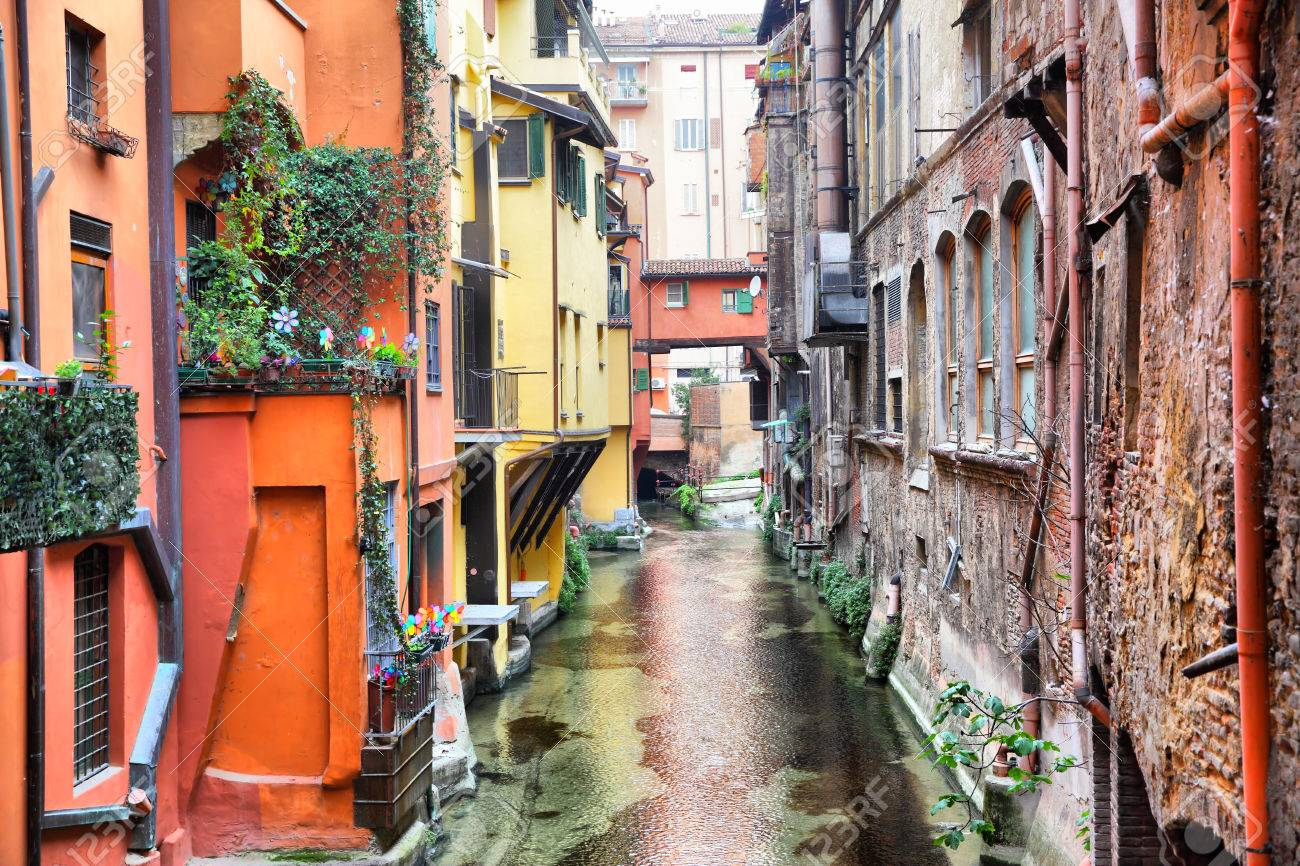 Canal in the old town of Bologna, Italy - 67376116