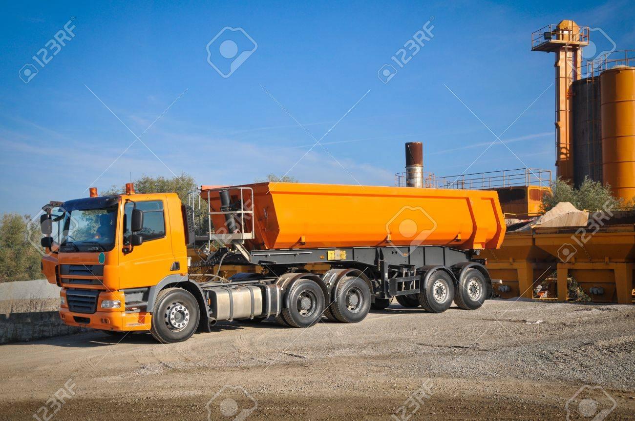 Concrete mixer truck orange truck in asphalt factory