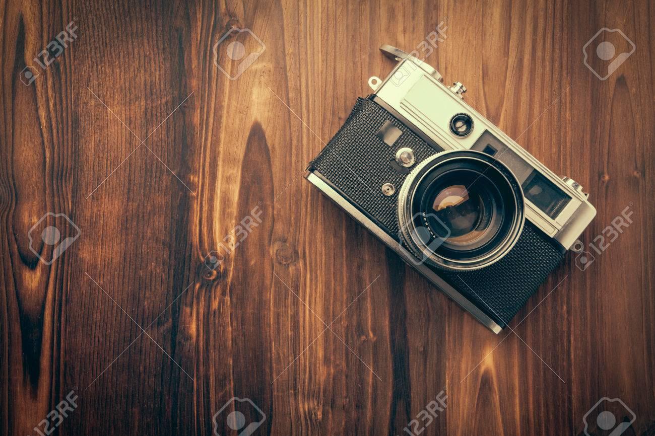 Vintage camera on wooden background Stock Photo - 25410405