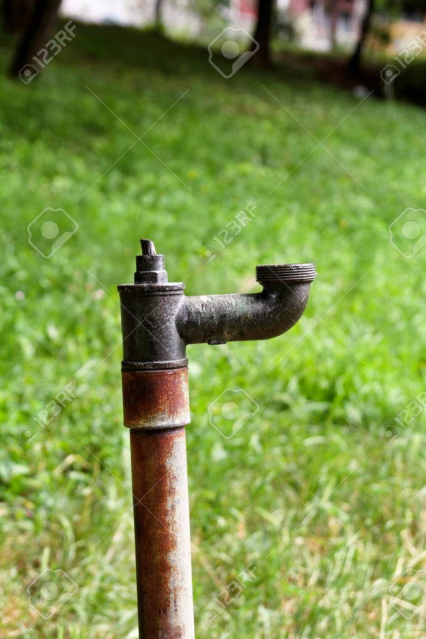 Old Water Pipes Outside / Faucet With Nature Background / A Old ...