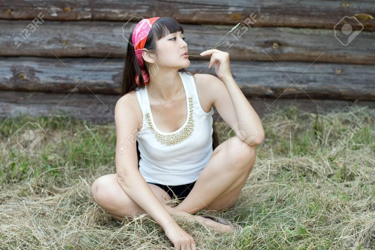 Beautiful girl sitting on hay Stock Photo - 9952677