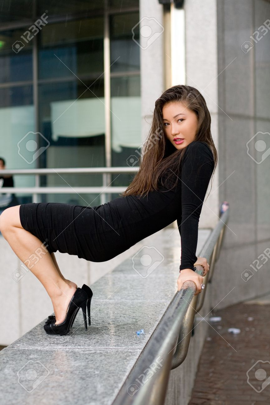 Sexy Girl In Black Dress Walking In City Stock Photo, Picture And ...