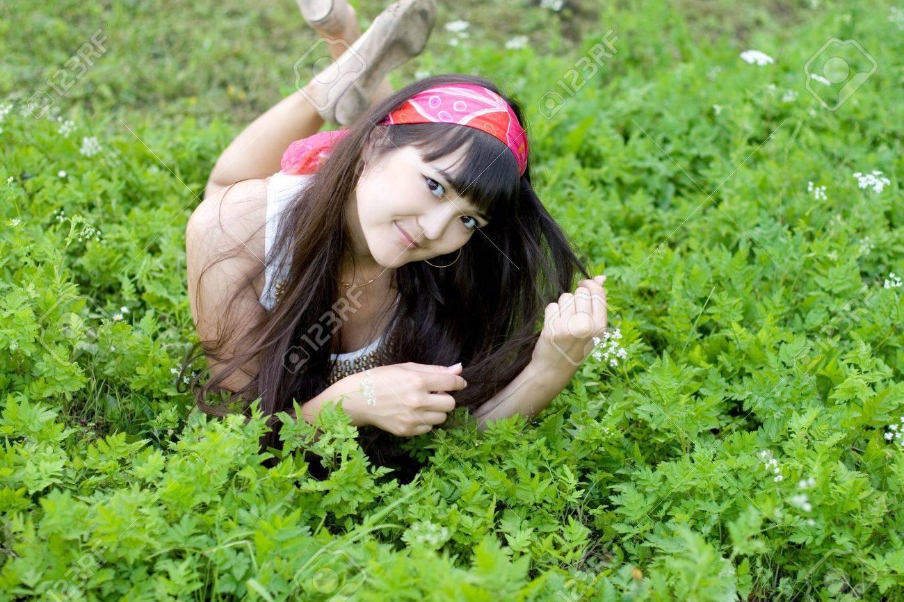 Pretty girl lying on grass Stock Photo - 9989690