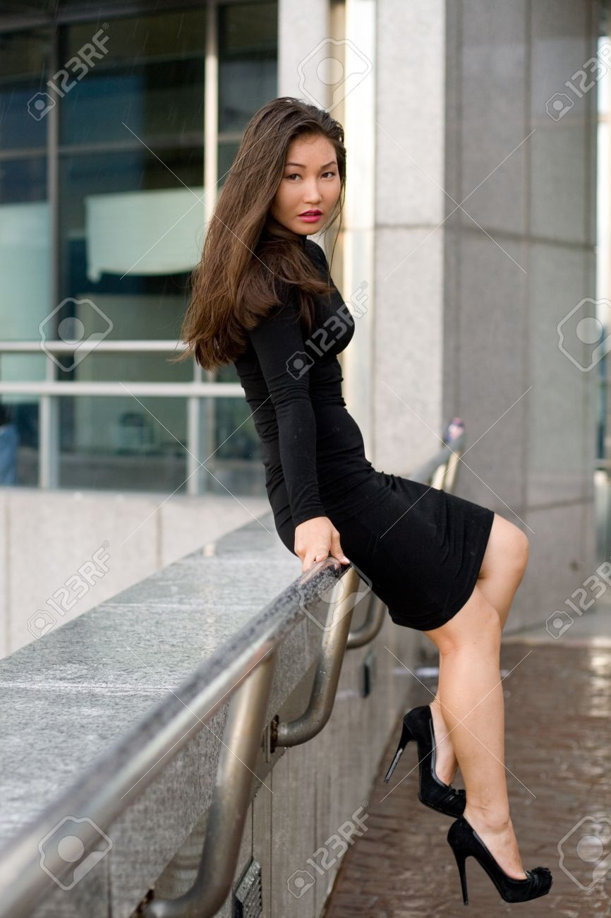 Sexy girl in black dress walking in city Stock Photo - 10423082