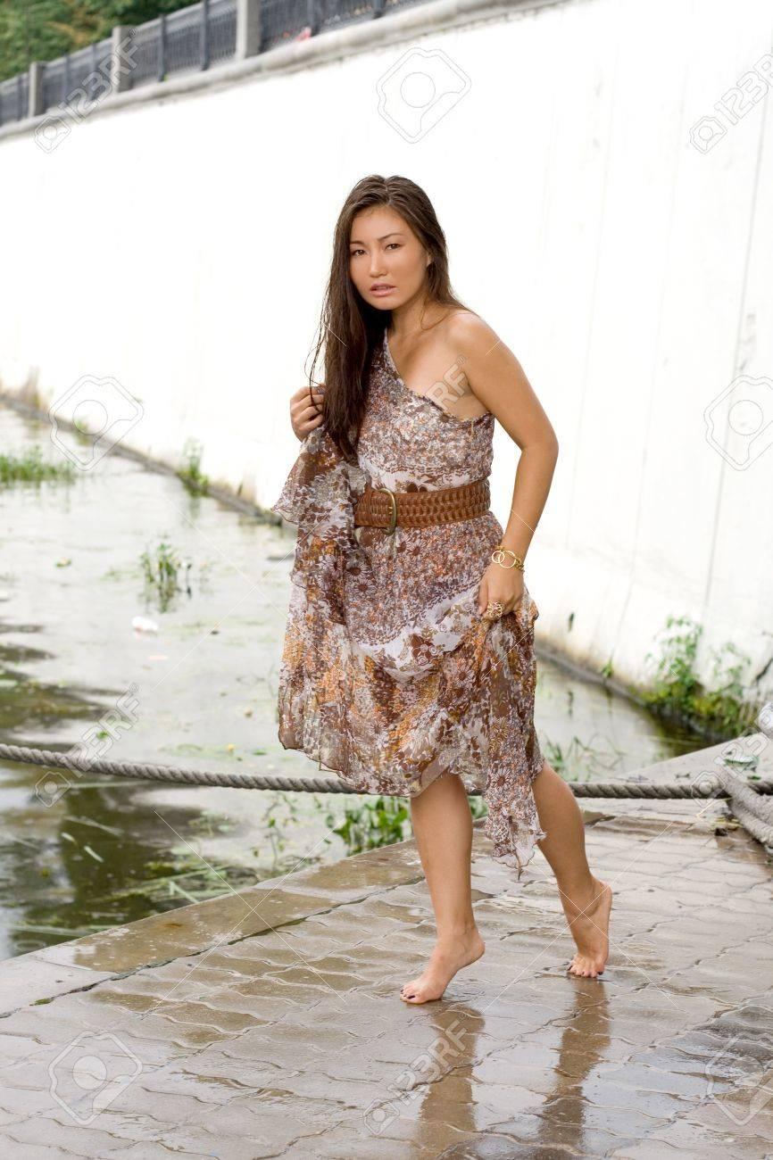 Beautiful girl walking near river Stock Photo - 10660038