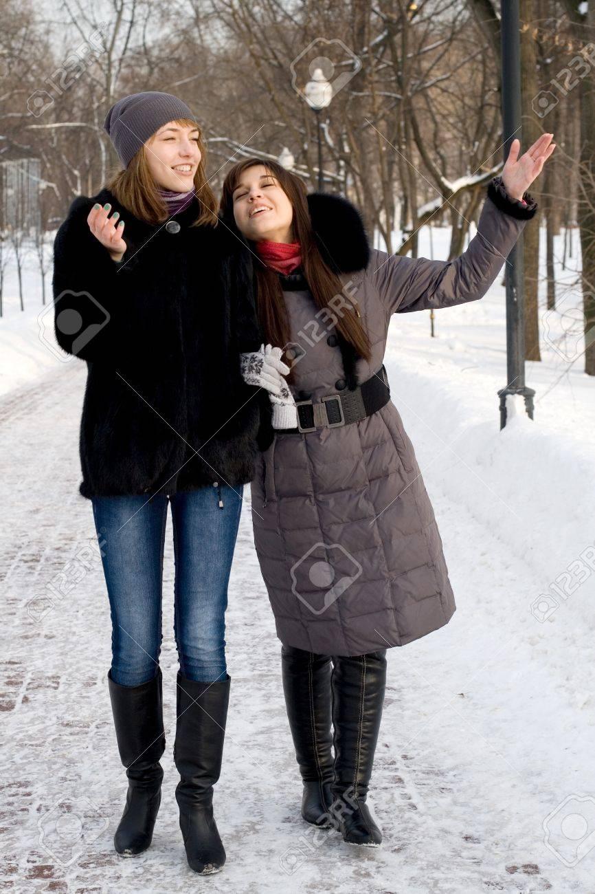 Two female friends walking in park in winter Stock Photo - 12469833