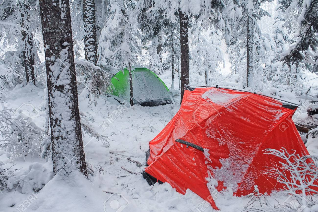 Red tent in winter forest. Tourist c& in snowy forest. Tent in the snow & Red Tent In Winter Forest. Tourist Camp In Snowy Forest. Tent ...