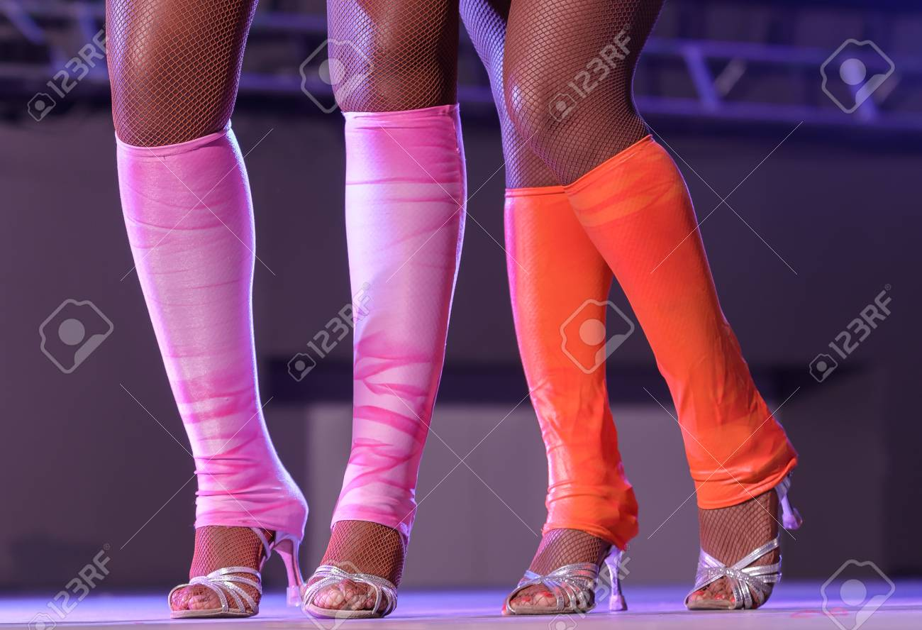 83a4f52d003 female legs of an attractive cabaret dancer in fishnet stockings. women s  feet in shoes with
