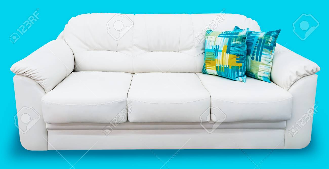 Stock Photo   White Eco Leather Sofa With Blue Pillow. Soft Snow White Couch  With Coach Type Screed Capitone. Classic Divan On Isolated Background
