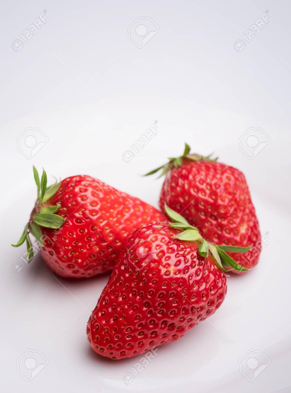 Strawberries on white background - 115523387