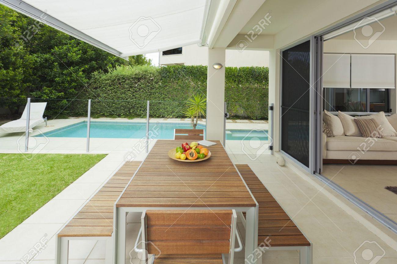 modern suburban backyard and living room with table setting and