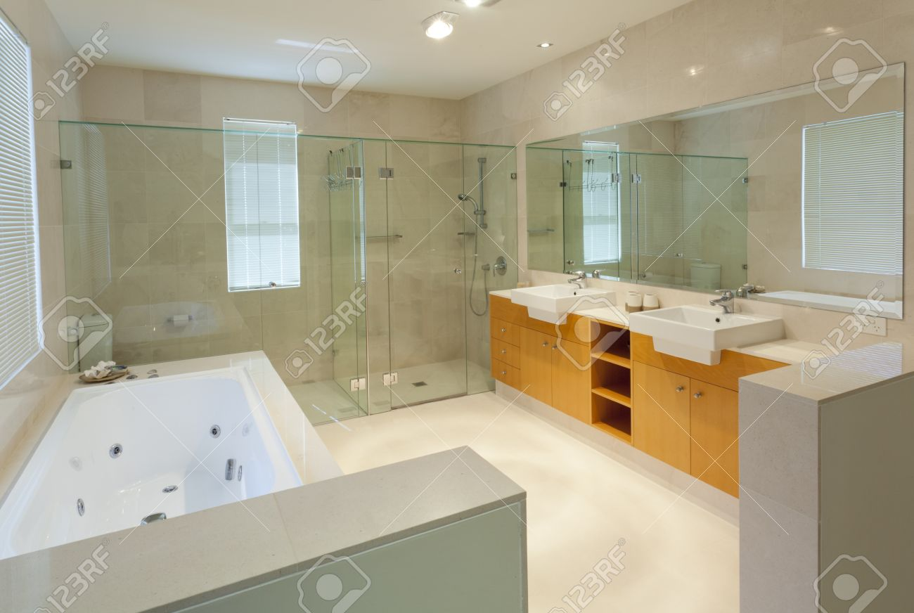 Modern Marble Bathroom With Twin Sinks, Shower And Bath Tub Stock ...