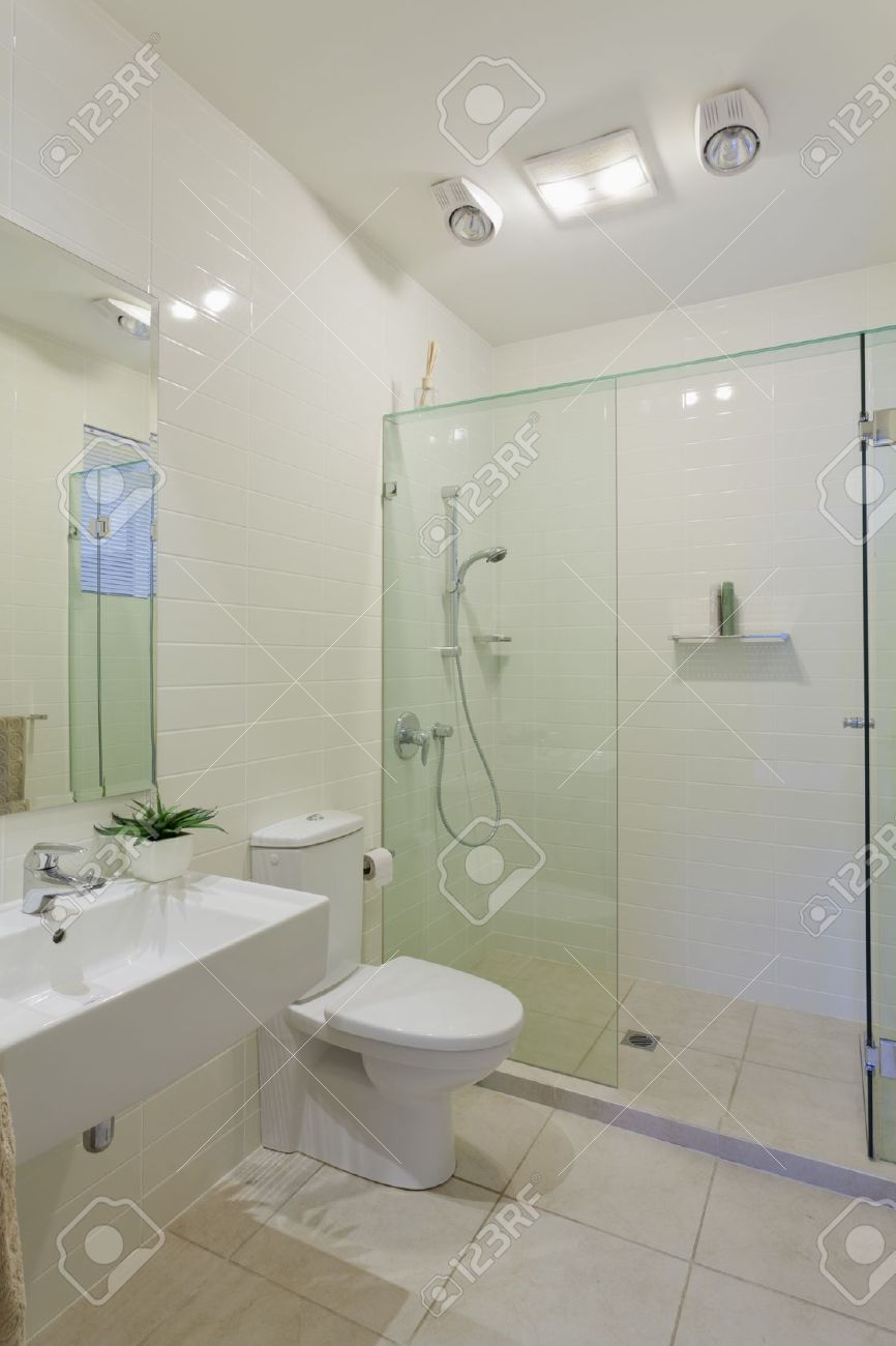 Stylish Modern Bathroom With Shower, Sink And Toilet Stock Photo ...